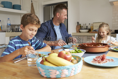 father and children at home in