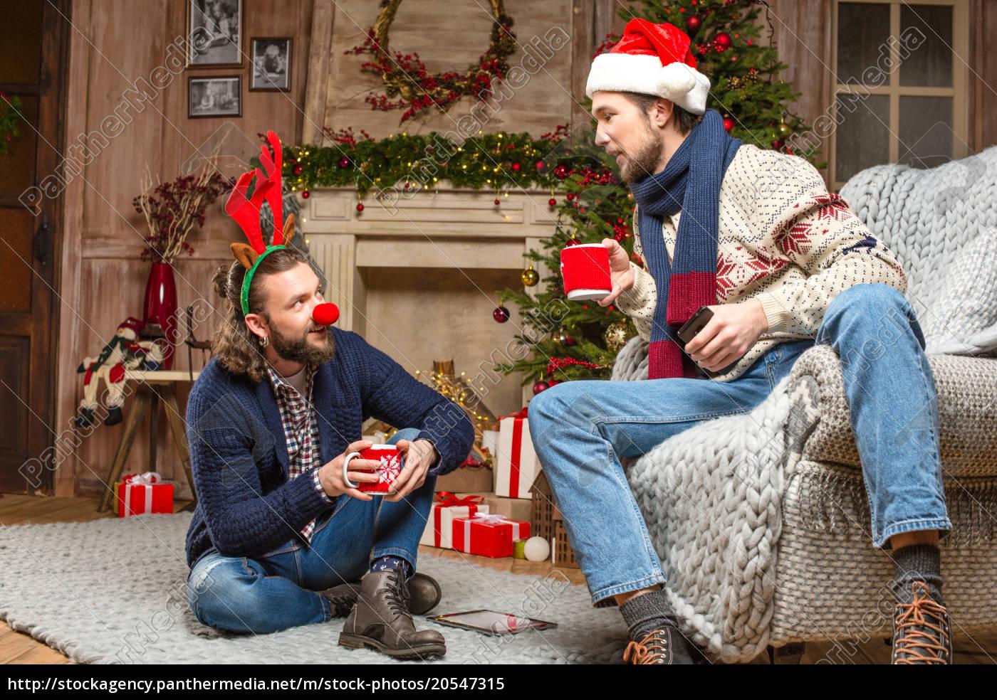 men, in, christmas, costumes, drinking, tea - 20547315