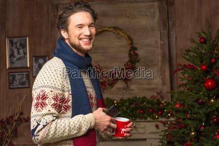 smiling, man, waiting, for, christmas - 20547357
