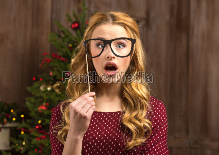 surprised, woman, holding, party, glasses - 20547591