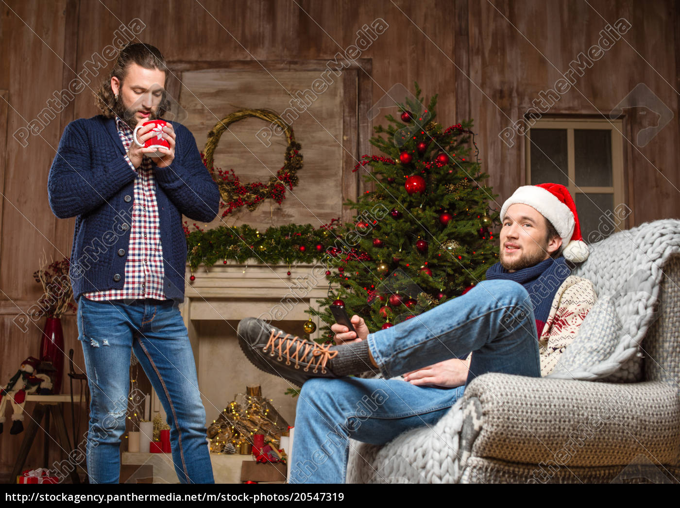 young, men, waiting, for, christmas - 20547319