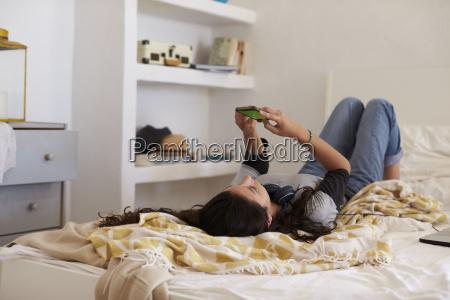 teenage girl lying on her back