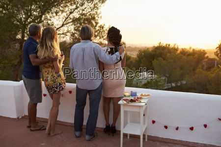 two couples admire view from rooftop