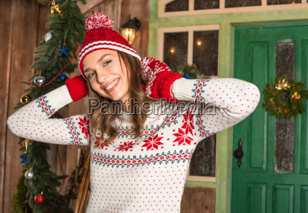 smiling woman in hat and mittens