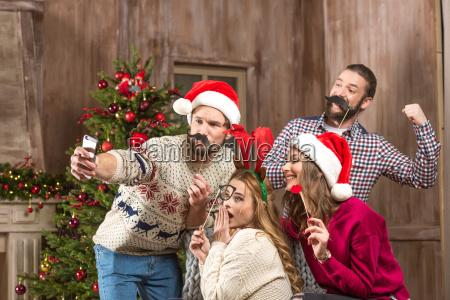 happy, people, taking, selfie, at, christmastime - 20548319