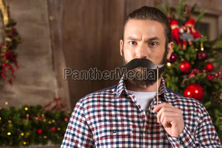 serious, man, holding, paper, moustache - 20548117