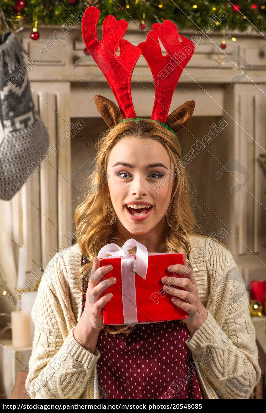 surprised, woman, holding, christmas, present - 20548085