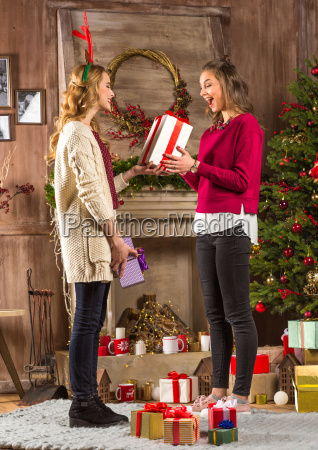 women, sharing, christmas, presents - 20548063