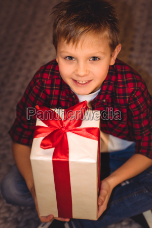 boy holding gift box