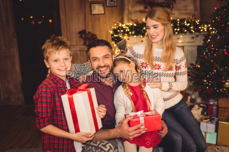happy family with christmas presents