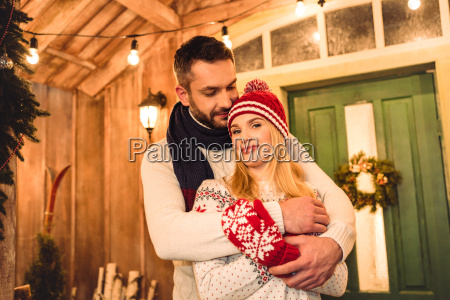 couple, in, knitted, sweaters, hugging - 20549961