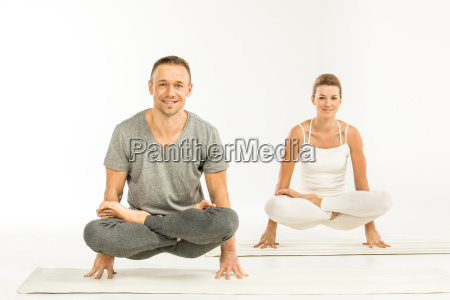 couple, sitting, in, yoga, position - 20549285