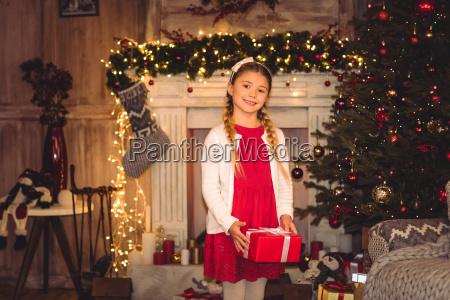 girl, holding, christmas, present - 20549589