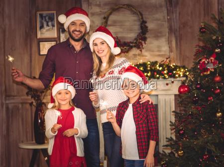 happy, family, in, santa, hats - 20549949