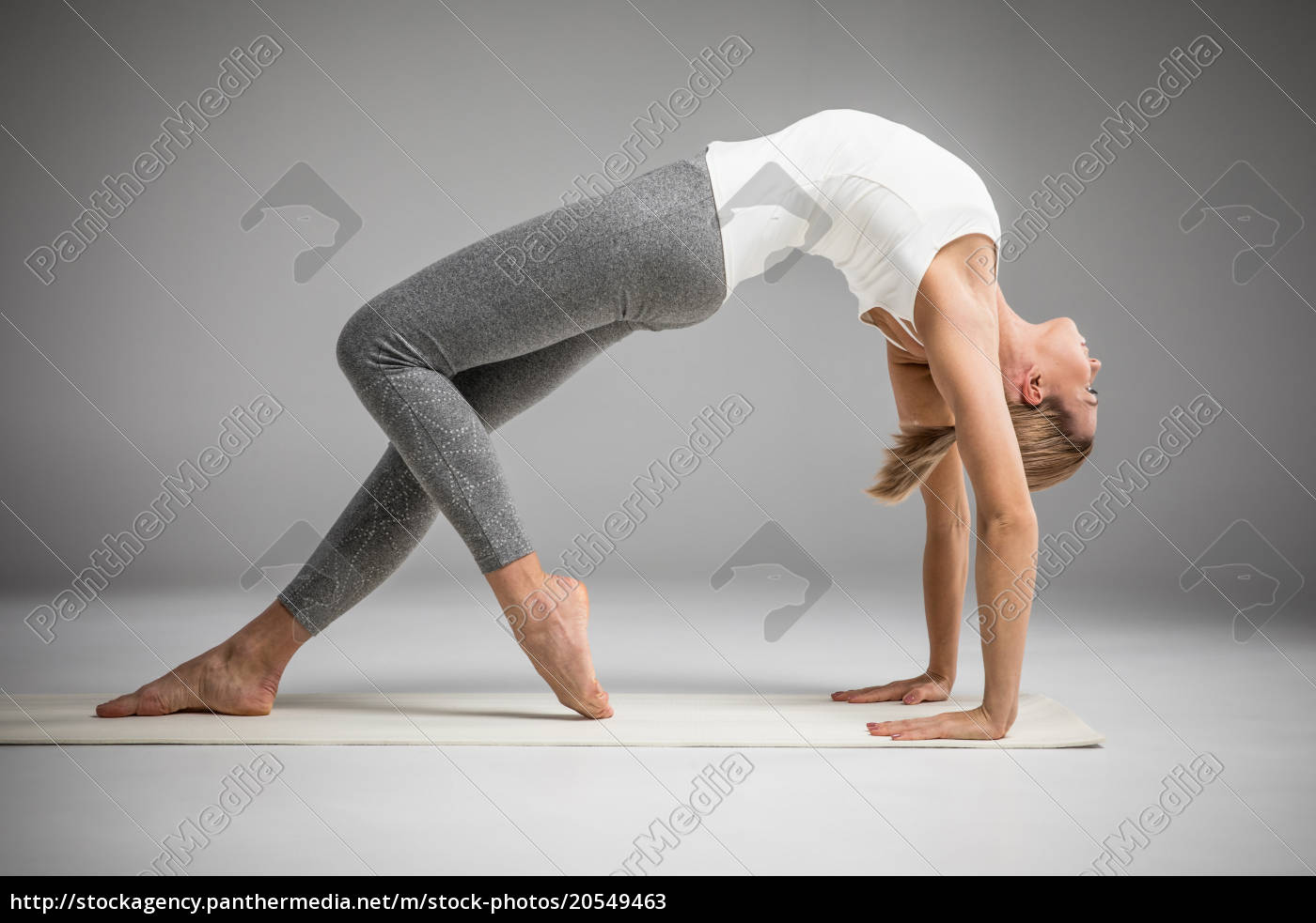 woman, standing, in, yoga, position - 20549463