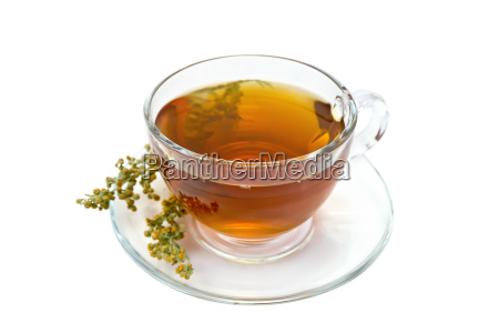tea with wormwood in glass cup