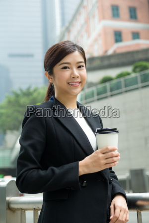 asian, young, businesswoman, enjoy, her, coffee - 20551313