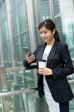 businesswoman, having, coffee, and, look, at - 20551261