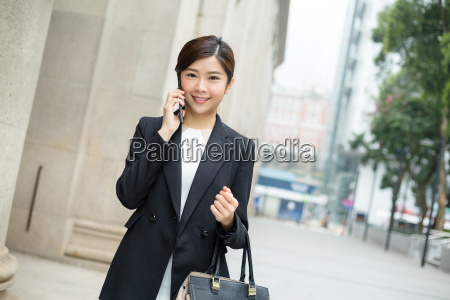 businesswoman, talking, to, cellphone - 20551241