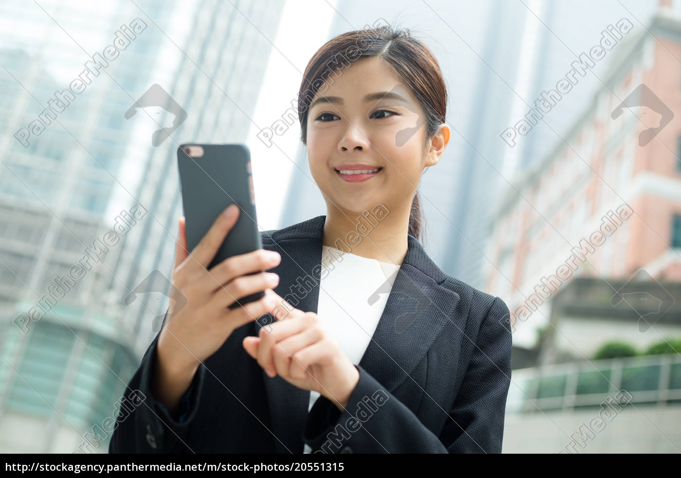 businesswoman, use, of, mobile, phone - 20551315