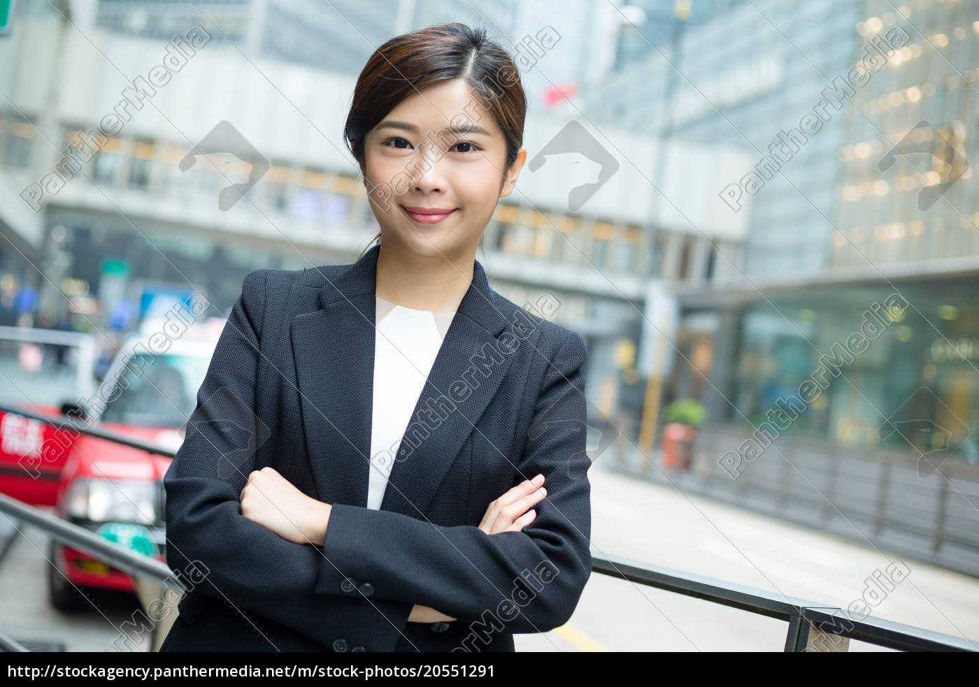 young, businesswoman, standing, at, outdoor - 20551291