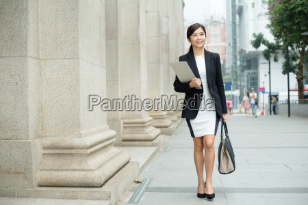 young, businesswoman, walking, on, street - 20551249