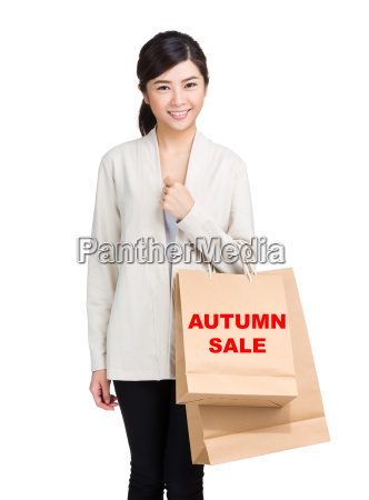 young, woman, holding, shopping, bag, and - 20551221