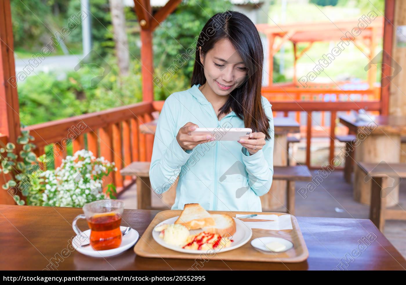 woman, taking, photo, on, her, breakfast - 20552995
