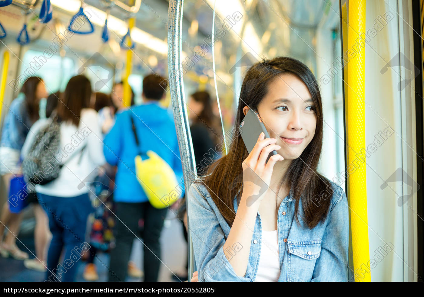 woman, talk, to, cellphone, in, train - 20552805