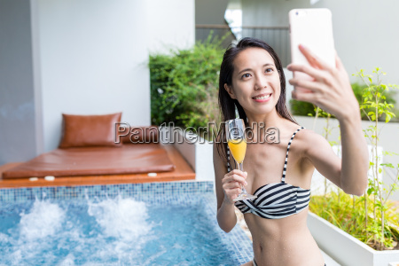 woman taking selfie in jacuzzi