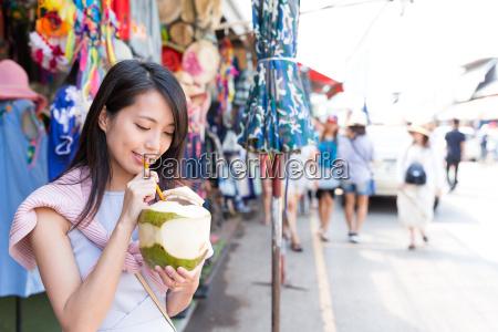 woman drinking of coconut in weekend
