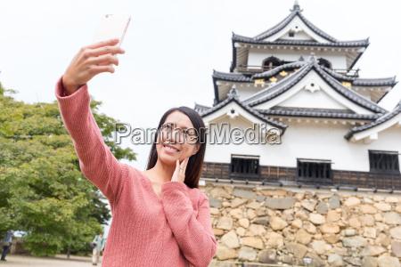 asian, woman, taking, selfie, by, mobile - 20553007