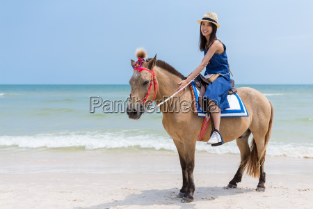 beautiful, woman, riding, horse, in, sand - 20553351