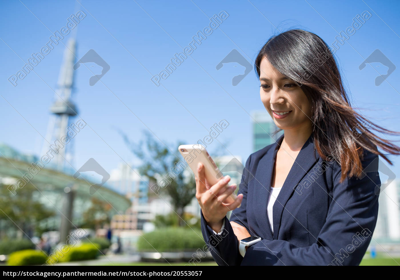 businesswoman, using, cellphone, at, nagoya, city - 20553057