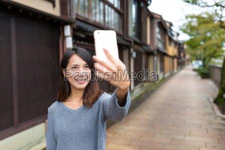 woman, taking, self, photo, on, mobile - 20553071