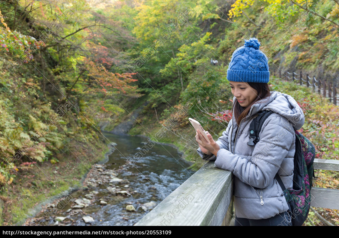 woman, using, cellphone, in, forest - 20553109