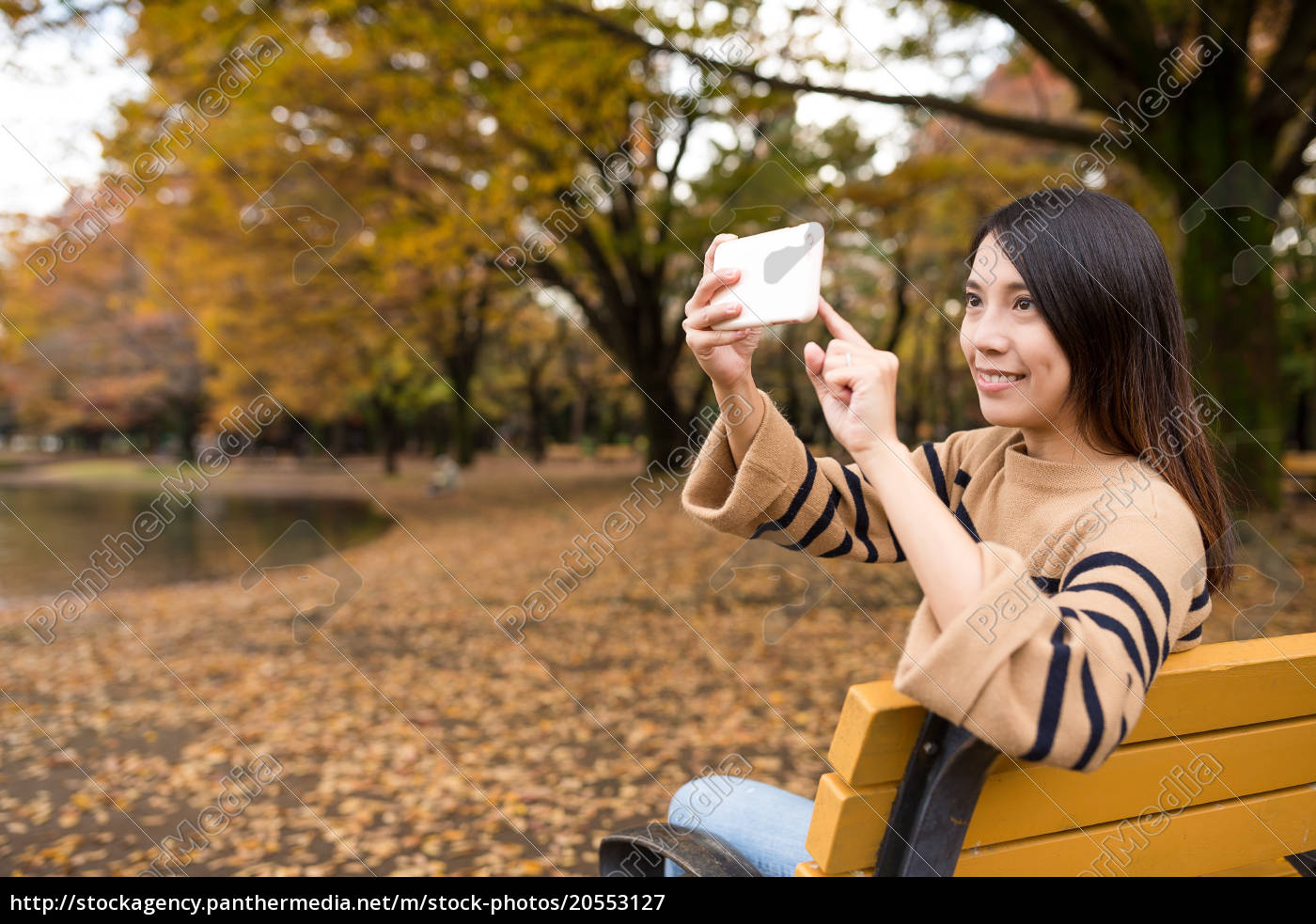 woman, using, mobile, phone, to, take - 20553127