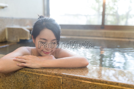 young, woman, relaxing, in, japanese, onsen - 20553091