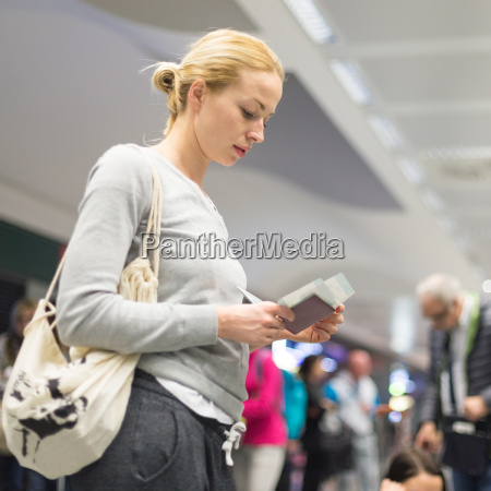 casual woman waiting for her flight