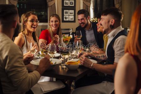 friends, enjoying, a, meal - 20556607