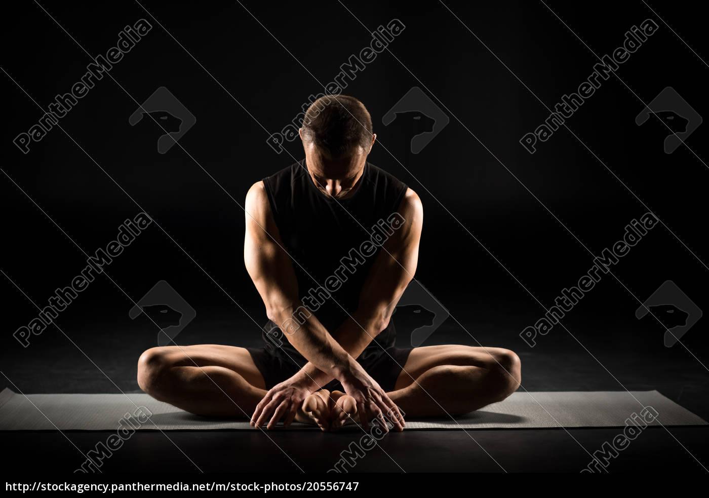man, sitting, in, yoga, position - 20556747