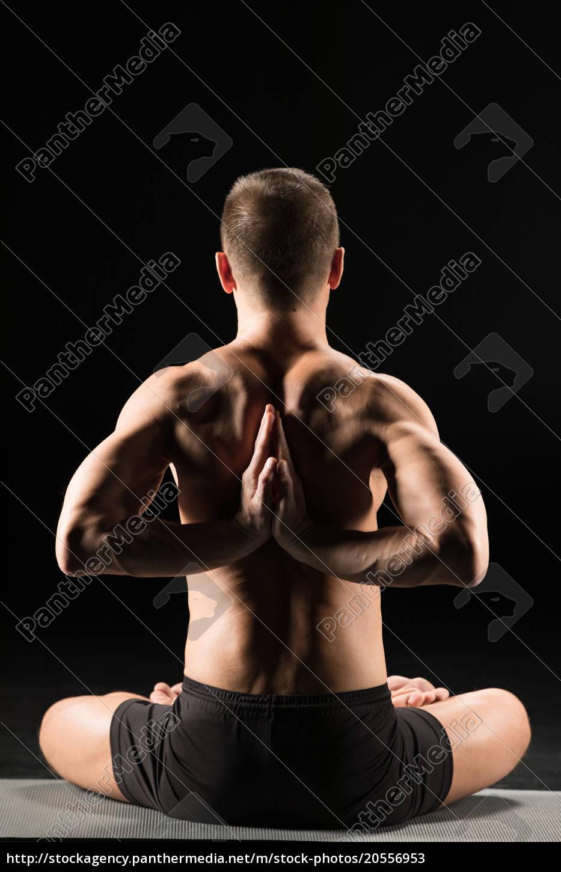 man, sitting, in, yoga, position - 20556953