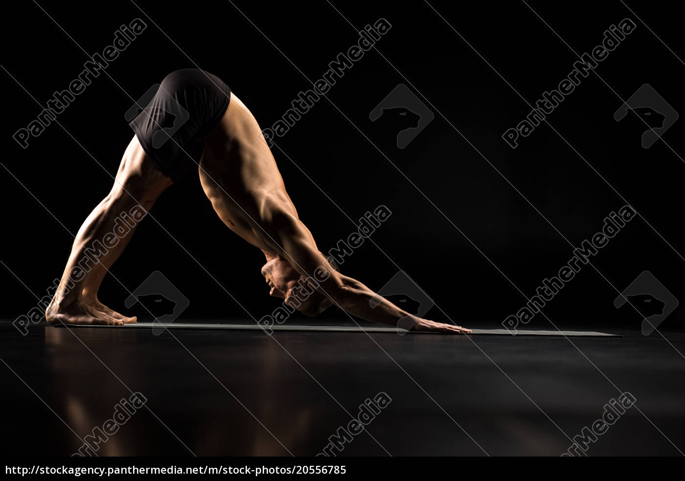 man, standing, in, yoga, position - 20556785