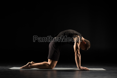 man, standing, in, yoga, position - 20556813