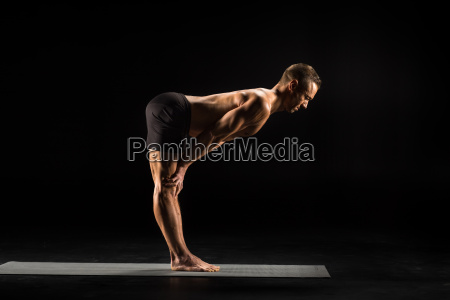man, standing, in, yoga, position - 20556833