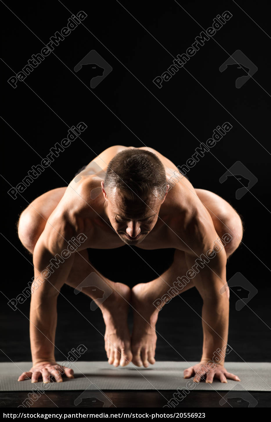 man, standing, in, yoga, position - 20556923