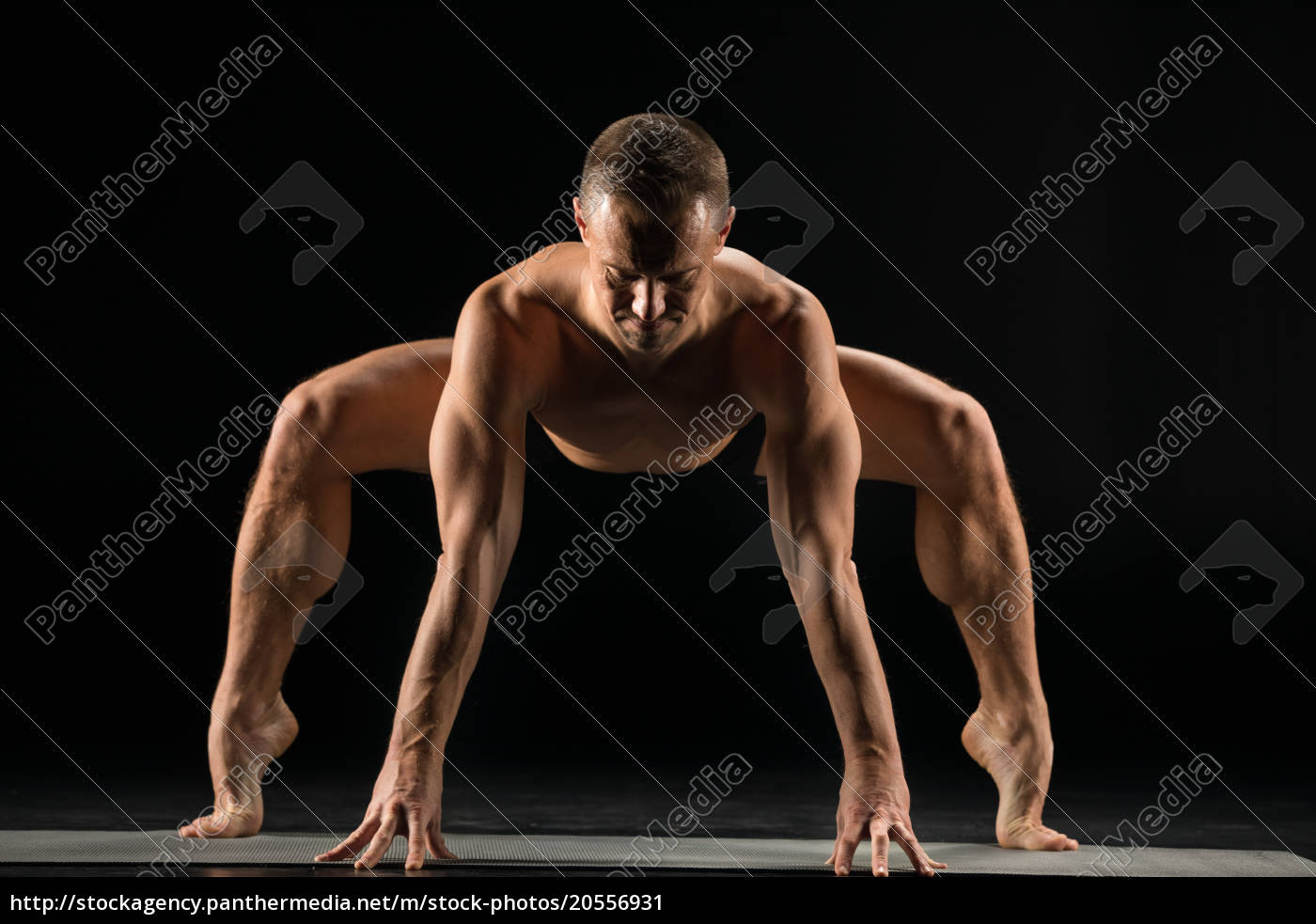 man, standing, in, yoga, position - 20556931
