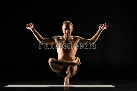 man, standing, in, yoga, position - 20556995