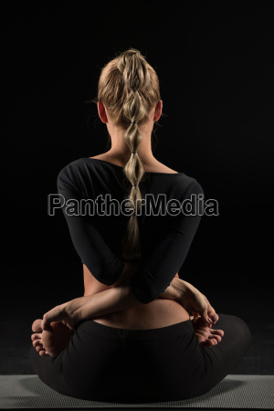 woman, sitting, in, yoga, position - 20556869
