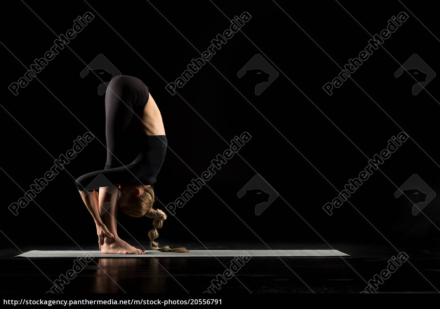 woman, standing, in, yoga, position - 20556791